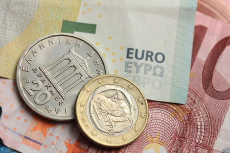 greek coins: Old Greek and modern greek euro coins on Euro bank notes