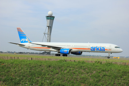 polderbaan: Amsterdam, The Netherlands - August 10 2015: 4X-BAW Arkia - Israeli Airlines Boeing 757-300 taxing on the Polderbaan runway to the main terminal of Amsterdam Schiphol Airport