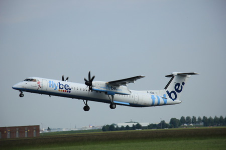 polderbaan: Amsterdam, The Netherlands - June 12 2015:  G-JECL Flybe De Havilland Canada DHC-8 takes of from Amsterdam Airport Polderbaan runway.