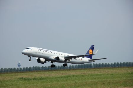 polderbaan: Amsterdam, The Netherlands - June 12 2015:  D-AEBJ Lufthansa CityLine Embraer ERJ-195 takes of from Amsterdam Airport Polderbaan runway. Editorial