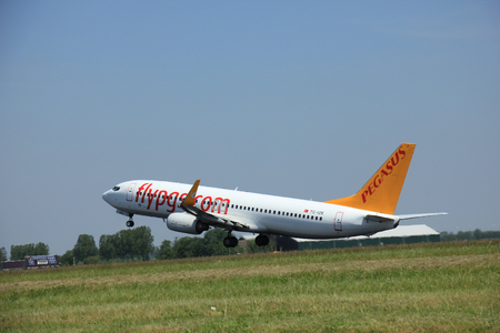 headquartered: Amsterdam, The Netherlands - June 12 2015: TC-IZE Pegasus Boeing 737-800 takes of from Amsterdam Airport Polderbaan runway. Pegasus Airlines is a low-cost airline headquartered in  Istanbul, Turkey. Editorial