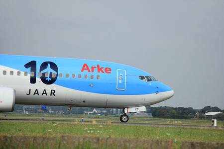 polderbaan: Amsterdam, The Netherlands - August 10 2015: PH-TFC Arke TUI Boeing 737-800  taxing on the Polderbaan runway to the main terminal of Amsterdam Schiphol Airport Editorial