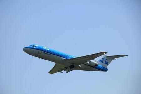 klm: Amsterdam, The Netherlands - June 12 2015: PH-KZR KLM Cityhopper Fokker F70 takes off at Amsterdam Airport Schiphol Polderbaan runway. Editorial