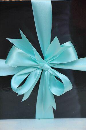 blue box: Black gift box with blue satin ribbon Stock Photo