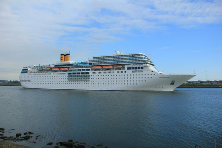 ijmuiden: june 13rd, 2014. IJmuiden: Costa Neo Romantica on North Sea Canal, towards North Sea