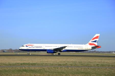 airways: March, 22nd 2015, Amsterdam Schiphol Airport G-EUXD British Airways Airbus A321-231 take off from Polderbaan Runway Editorial
