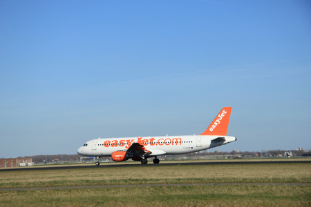 schiphol: March, 22nd 2015, Amsterdam Schiphol Airport G-EZTM easyJet Airbus A320-214 take off from Polderbaan Runway