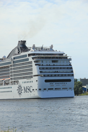 cruiseship: Velsen, the Netherlands, July 7th, 2014 : MSC Magnifica on North Sea Canal from Amsterdam towards the Ijmuiden locks, The Magnifica is operated by MSC since 2010 and  293.8 metres (964 ft) long.