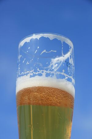 Glass of beer on a sunny summer day, blue sky