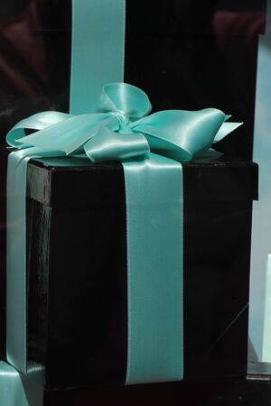 blue satin: Black gift box with a blue satin bow