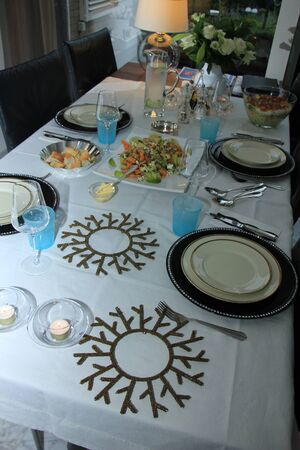 dinner table: Dinner table with classic and comtemporary crockery and flatware Stock Photo