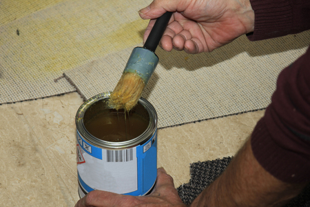 carpeting: Craftsman carpeting a staircase, putting glue on carpet