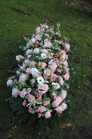 sympathy flowers: Sympathy flowers in pink and white on a grave