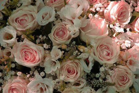 centerpiece: Pink roses in a bridal flower arrangement, centerpiece decorations