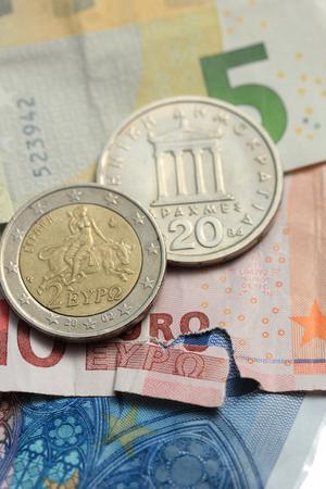 greek coins: Vintage greek Drachma coins on european banknotes