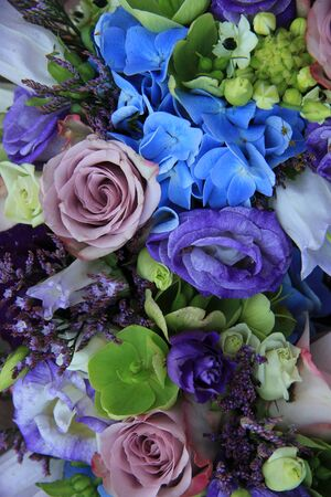 Blue Hydragea And Purple Roses In A Blue Purple Wedding Bouquet ...