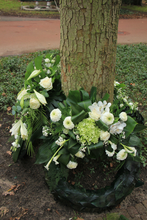 sympathy: Sympathy wreaths near a tree on a cemetery Stock Photo