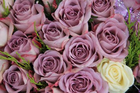 centerpiece: Purple roses in a big centerpiece wedding arrangement