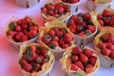 fruit market: Strawberries in small thin wooden boxes at a local French market