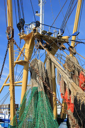 Fishing nets on a mid size trawler Stock Photo
