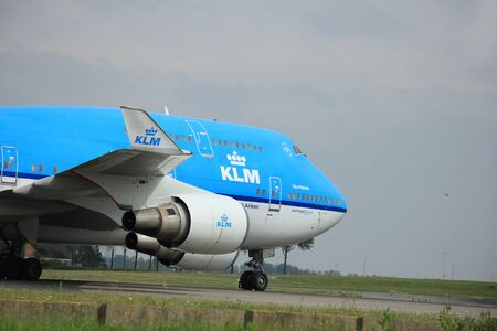 747 400: Amsterdam, The Netherlands - August 10 2015: PH-BFN KLM Royal Dutch Airlines Boeing 747-400  taxing on the Polderbaan runway to the main terminal of Amsterdam Schiphol Airport