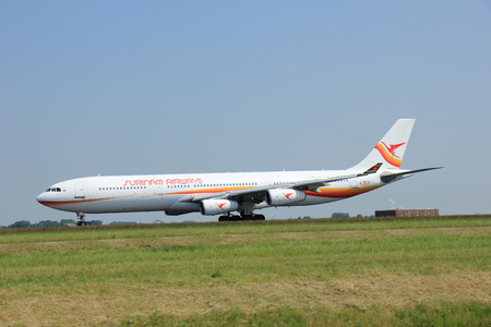 airways: Amsterdam, The Netherlands - June 12 2015:  PZ-TCP Surinam Airways Airbus A340 takes of from Amsterdam Airport Polderbaan runway. Surinam Airways, also known by its initials SLM, is the flag carrier of Suriname, based in Paramaribo Editorial