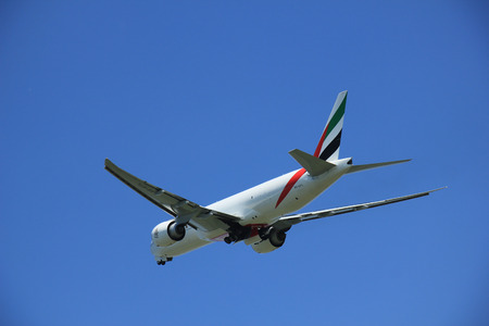 air freight: Amsterdam, The Netherlands - June 12 2015: A6-EFL Emirates Boeing 777F takes off at Amsterdam Airport Schiphol Polderbaan runway. Emirates SkyCargo is a cargo airline based in Dubai, United Arab Emirates. It is the air freight division of Emirates. Editorial
