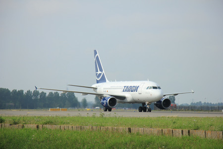 polderbaan: Amsterdam Schiphol Airport - August, 10th 2015: YR-ASB TAROM Airbus A318-111 taxing after landing on the Polderbaan to main terminal Schiphol Airport Editorial