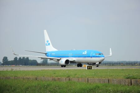 polderbaan: Amsterdam Schiphol Airport - August, 10th 2015: PH-BXK KLM Royal Dutch Airlines Boeing 737 taxing after landing on the Polderbaan to main terminal Schiphol Airport
