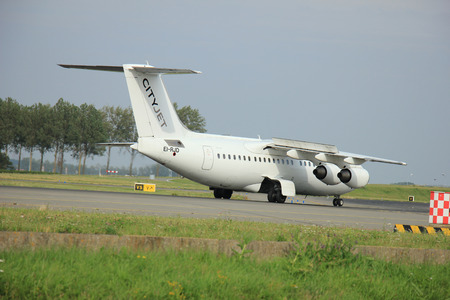 aerospace: Amsterdam Schiphol Airport - August, 10th 2015: EI-RJD Cityjet British Aerospace Avro RJ85 taxing after landing on the Polderbaan to main terminal Schiphol Airport
