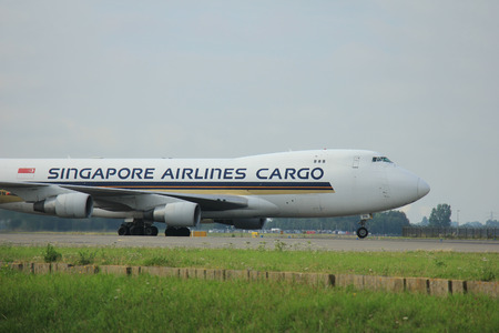 polderbaan: Amsterdam, The Netherlands - August 10 2015: 9V-SFN Singapore Airlines Cargo Boeing 747-400F  taxing on the Polderbaan runway to the main terminal of Amsterdam Schiphol Airport