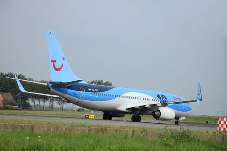 polderbaan: Amsterdam, The Netherlands - August 10 2015: PH-TFC Arke Boeing 737-800  taxing on the Polderbaan runway to the main terminal of Amsterdam Schiphol Airport