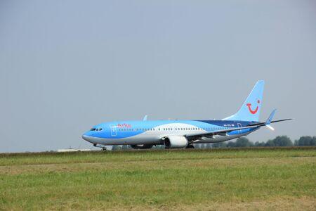 polderbaan: Amsterdam, The Netherlands - June 12 2015: PH-TFD Arke Boeing 737-800 takes of from Amsterdam Airport Polderbaan runway.