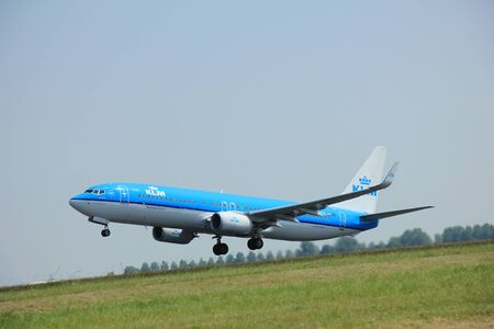 klm: Amsterdam, The Netherlands - June 12 2015:  PH-BCE KLM Royal Dutch Airlines Boeing 737-800  takes of from Amsterdam Airport Polderbaan runway. Editorial