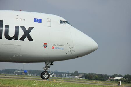 polderbaan: Amsterdam, The Netherlands - August 10 2015: LX-VCG Cargolux Airlines International Boeing 747-8F taxing on the Polderbaan runway to the main terminal of Amsterdam Schiphol Airport