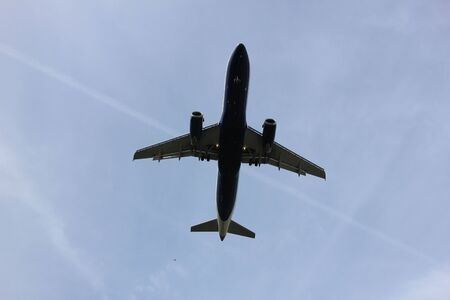 underneath: Commercial airplane approaching the runway