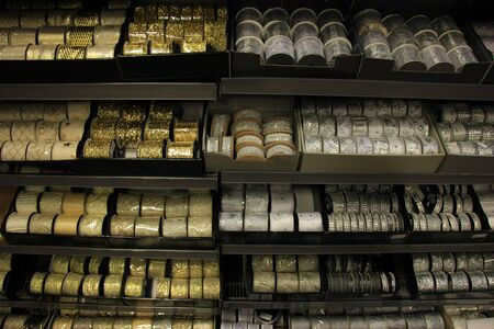 selling stocks: Christmas ribbons in a store, in gold and silver