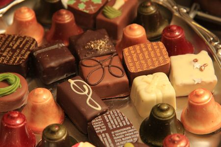 Collection of luxurious Christmas chocolates with different christmas themed decorations