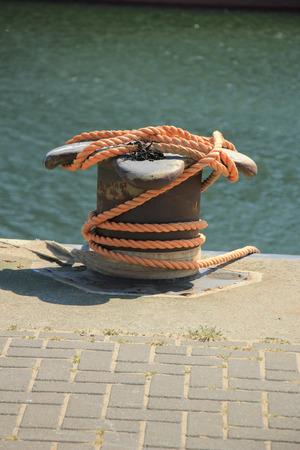 bollard: rusty mid size bollard in a port