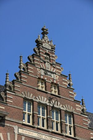 gable: Crow-stepped gable on an ancient building in the Netherlands Stock Photo