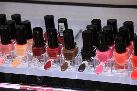 nailpolish: Nailpolish display in a store showing all various colors Stock Photo