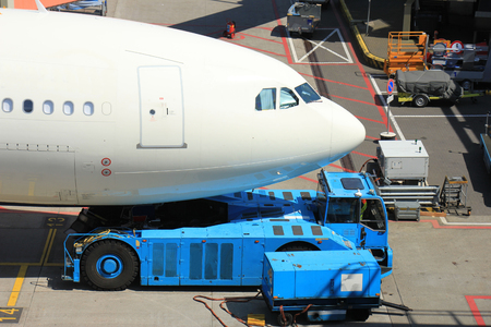 the back gate: Big airplane pushed back from the gate Stock Photo