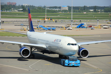 departing: Amsterdam The Netherlands -  May 13th 2016: N823NW Delta Air Lines Airbus A330, pushed back from gate at Amsterdam Schiphol Airport, departing to Minneapolis, United States