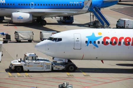 pushed: Amsterdam The Netherlands -  May 13th 2016: PH-CDH Corendon Dutch Airlines pushed back from the gate, departing to Ohrid, Macedonia Editorial