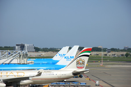 klm: Amsterdam The Netherlands -  May 13th 2016:A6-EYO Etihad Airways Airbus A330 and several KLM Asia planes, parked on Amsterdam Schiphol Airport Editorial