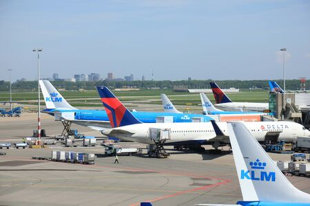 klm: Amsterdam The Netherlands -  May 13th 2016: planes from Delta Airlines and KLM parked on Amsterdam Schiphol Aiport