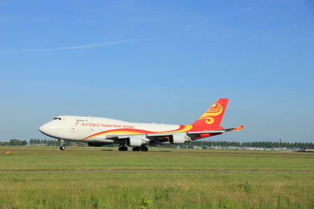 takeoff: Amsterdam, the Netherlands - June 9th 2016: B-2432 Yangtze River Express Boeing 747-481, takeoff from Polderbaan runway Schiphol, destination Tianjin, China