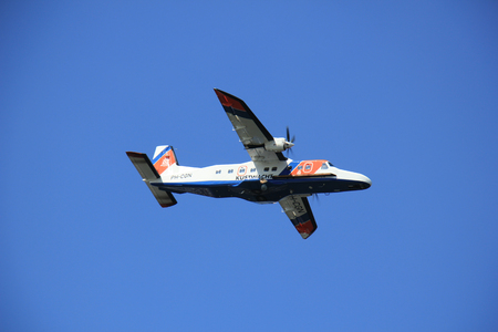 coastguard: Velsen, the Netherlands - May 6th 2016: PH-CGN The Netherlands Coastguard Dornier , in flight over North Sea Canal