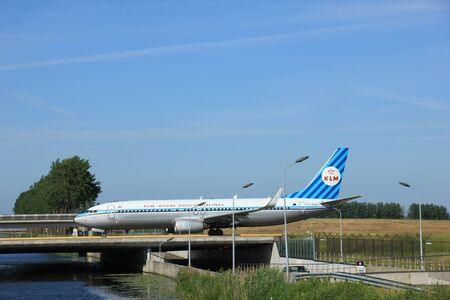 livery: Amsterdam, the Netherlands - June 9th 2016: PH-BXA KLM Royal Dutch Airlines Boeing 737, taxiing to Polderbaan runway Schiphol, destination Rome, Italy. Retro livery for KLM 90th anniversary