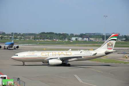 livery: Amserdam The Netherlands -  May 13th 2016:A6-EYO Etihad Airways Airbus A330, Formula 1 2016 livery, arriving from Abu Dhabi, United Arab Emirates
